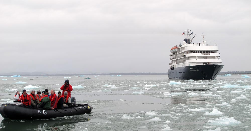 expedition ship and zodiac in the ice, image by Damon Ramsey.