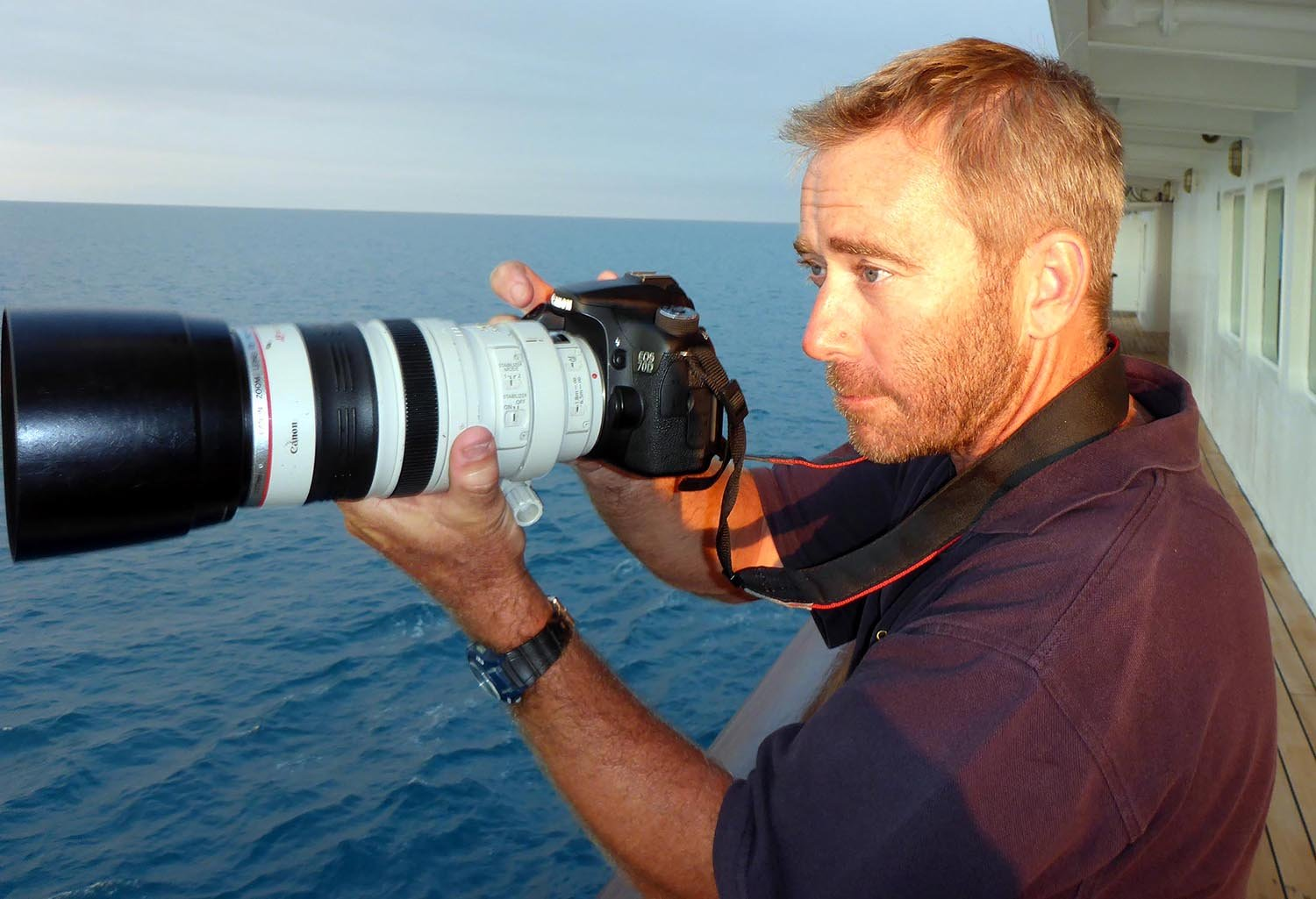 Damon Ramsey portrait on a ship, with a camera